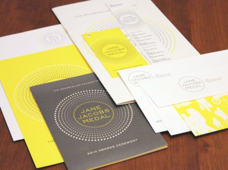 The entire event package with Save-the-Date card, invitation, RSVP card, program, coat check tag and bookmark.